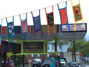 Arlington Service Station COVID-19 Masks Installation by Johnny Lapham, Laurie Bogdan,  Kimberley Harding, Heritage Flag, and community activist artist volunteers